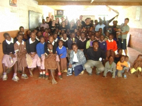 Group photo with children from Mama Tunza Children's Home and visitors